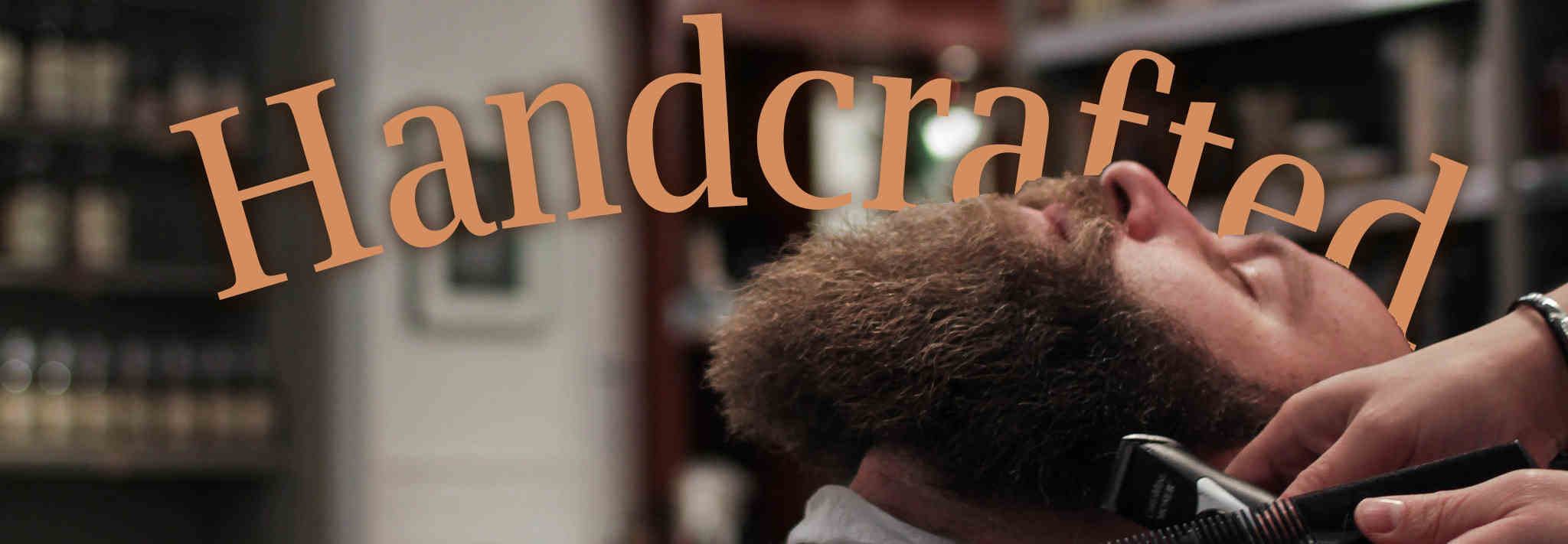 A barber carefully shaves an enormous beard